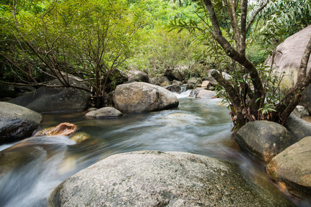 enrich: water from uphill to river Stock Photo