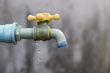 water conservation: Leaky tap is wasting water  Stock Photo