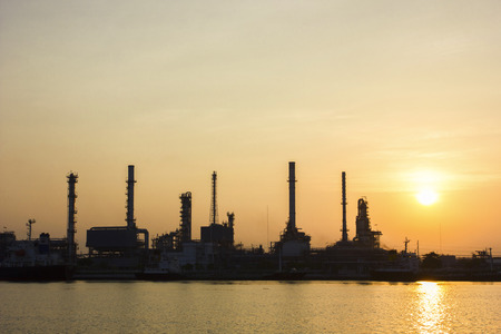 Oil refinery view with Sunrise photo