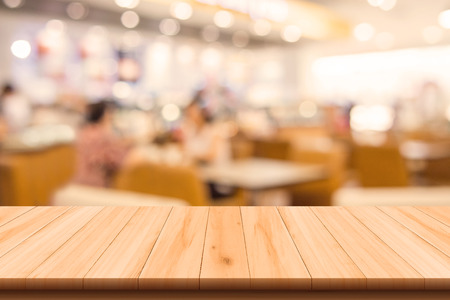 wood floor background: Restaurant and Coffee shop blurred background with bokeh and wooden floor