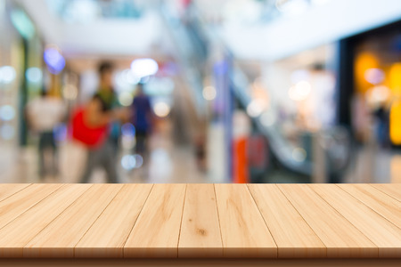 Shopping mall blur background and wooden floor