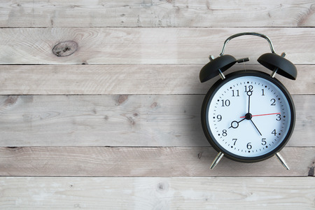 clock: Alarm clock with wooden floor Stock Photo