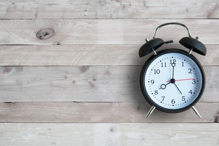 Alarm clock with wooden floor Foto de archivo
