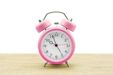 Alarm clock isolated whit wooden floor