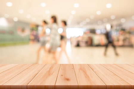 Shopping mall blurred background with wooden floor Stock Photo