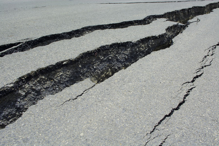 Asphalt road cracks and collapsed
