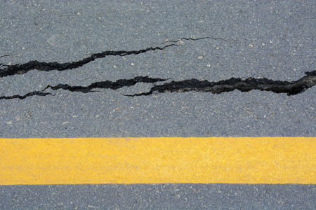 collapsed: Asphalt road cracks and collapsed