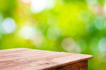 Abstract nature blurred background with bokeh and wooden table floor Stock Photo
