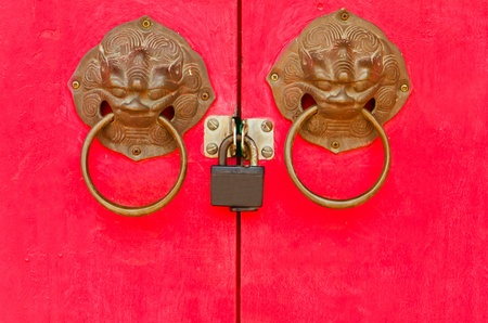 lion bolt on red door in Chinese temple photo