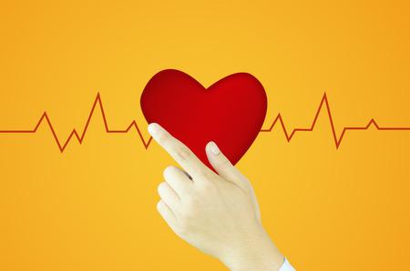 writes: Human hand writes heart and graph