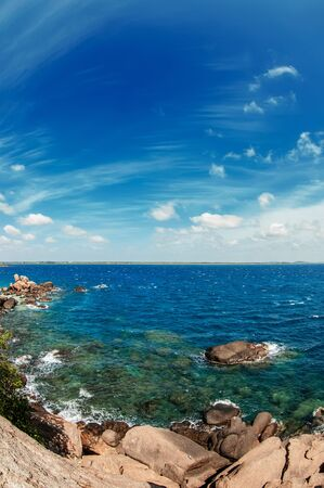 Beautiful seascape with clear water and blue sky with clouds. Sri lanka.