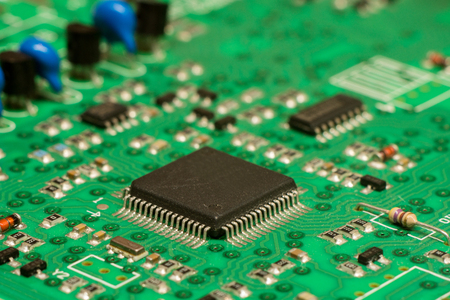 smd printed electronic circuit board with micro controller and components, shallow dof 版權商用圖片