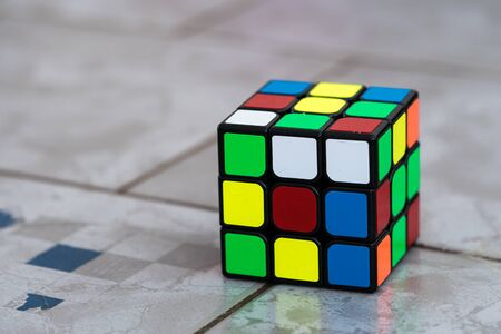 Sarajevo, Bosnia and Herzegovina- February 24, 2018 : Unsolved Rubik's cube on ceramic background. Editorial