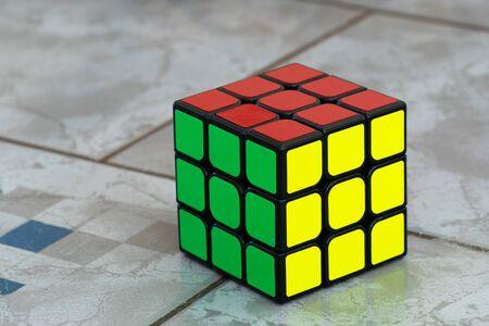 Sarajevo, Bosnia and Herzegovina- February 24, 2018 : Solved Rubik's cube on ceramic background.