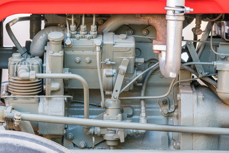 Detail of old tractor machine or engine. Whit visible fuel pump, air compressor, fuel filter and exhaust pipe. 版權商用圖片