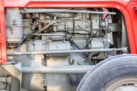 Detail of tractor machine or engine. Whit visible fuel pump, engine starter, oil filter and generator. Standard-Bild