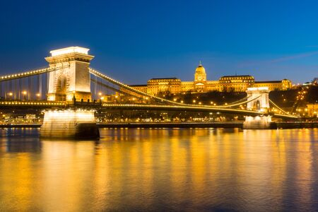 Chain bridge over Danube river at sunset in Budapest, Hungary