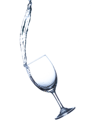 bubble background: Concept of drinking. Wine glass with splash water on white background Stock Photo