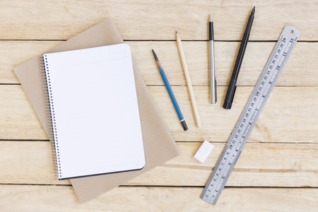 Stationery and Drawing equipment. on wood background