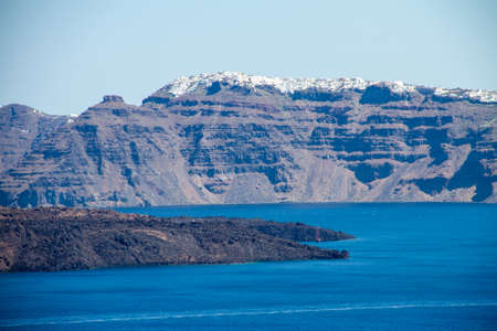 View of the inner coast of Santorini, sea from the Caldera area, city of Fira, volcano, blue sky, Greece