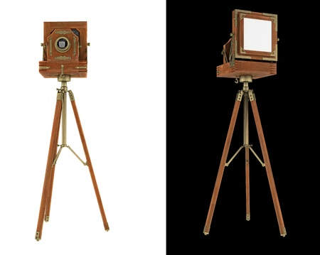 Old large format camera on tripod isolated on white photo