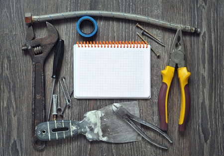 Set of different old Tools  and notepad photo