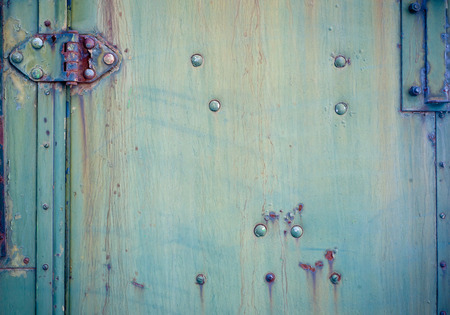 hinge joint: Background with Faded green chipped paint and hinge