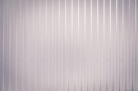 Gray toned Corrugated metal texture surface photo