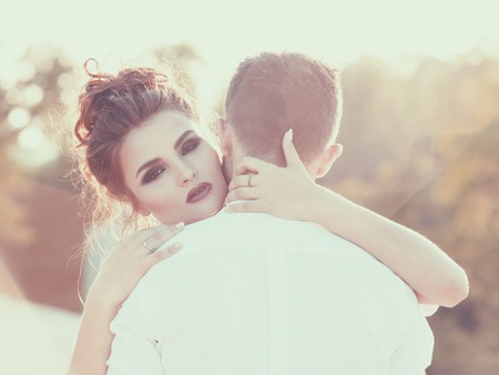 Warm embrace. Girl hugging her boyfriend. Vintage toning. Romantic concept for St.Valentine Day