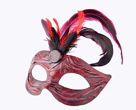 papier mache: Venetian red Carnival half mask with feathers, isolated on white background.  Handmade papier mache, acrylic paints, cloth and feathers Stock Photo