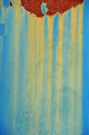 oxidate: Vertical Blue background with rust and yellow drips. Poisonous color
