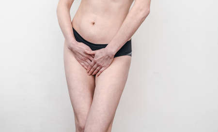 woman in panties is holding her hands between legs. Health, gynecology.