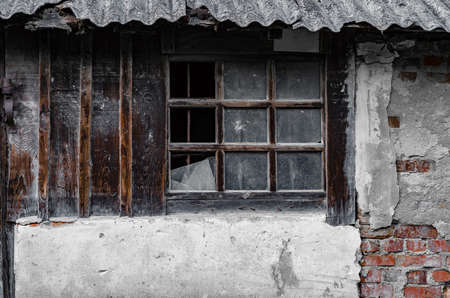 Old abandoned wall with a broken window. Stockfoto