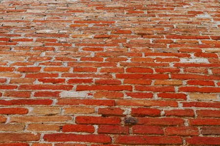 Wall piled of red old brick.