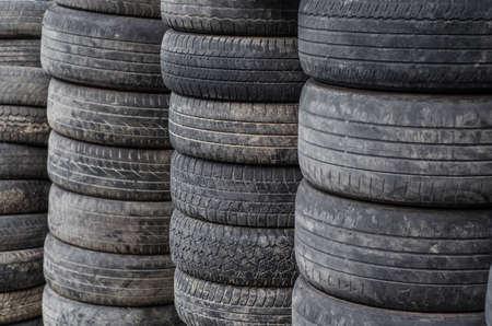 Old used car tires stacked in stacks Reklamní fotografie