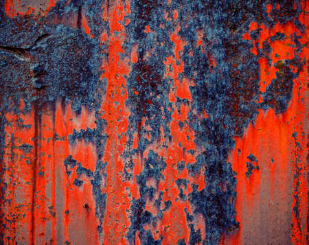 Rusty metal surface, orange and blue color of iron oxide