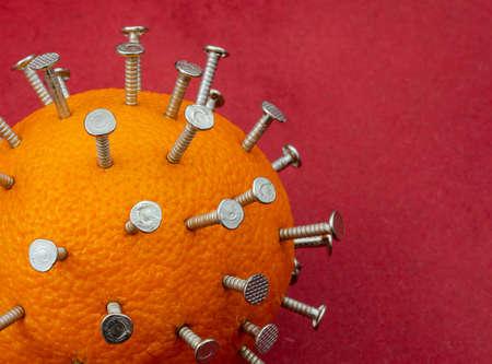 Conceptual image of virus. An orange studded with nails. Imitation of virus close-up. Chinese epidemic. Health hazard.