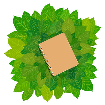 Eco-cardboard notebook framing green leaves