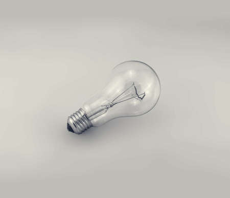 Electric bulb on a gray background. Banco de Imagens