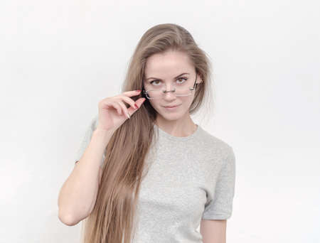 Sexy girl with long hair in glasses looking. Education, optics, training, student.