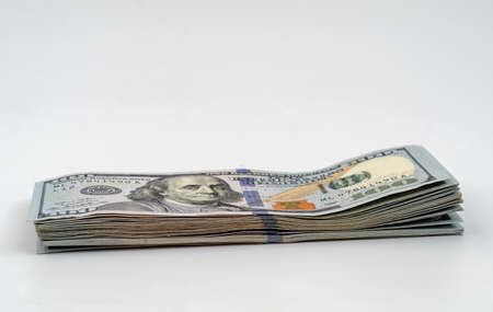 Stack of american dollars. Close-up on a white background