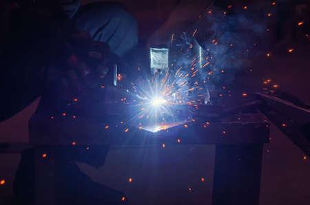 Metal welding in a metal workshop. Clear light blue tinting Stock fotó