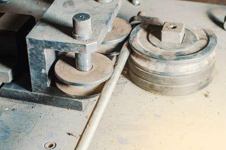 Pipe bending machine in the old workshop. Zdjęcie Seryjne