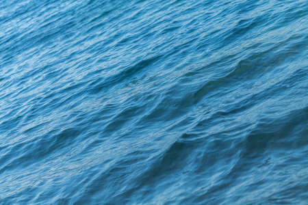 Small waves on the blue sea water. Nature background, travel vacation.