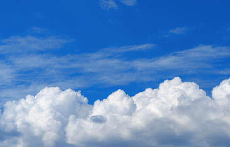 Cumulus clouds on background of blue sky