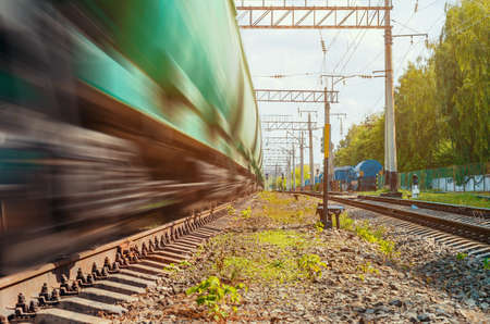 freight train travels on railway.