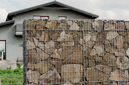 Gabion fence with natural stones inside.