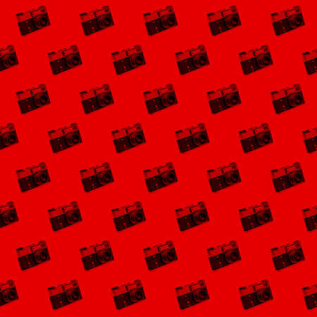 Seamless pattern of vintage photo camera red palette