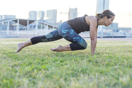 Beautiful girl is engaged in yoga in the park Stock Photo