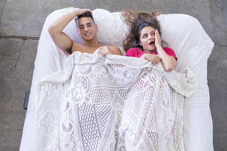 Attractive Caucasian man and woman having fun in bedroom. Love and happiness concept Foto de archivo
